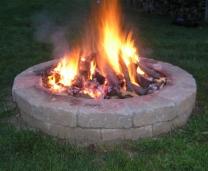 Outdoor wood burning firepit